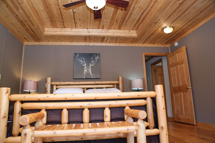 The wonderful Master Bedroom and King Size Bed are the perfect place to relax at the end of an adventurous day of hiking, fishing, water skiing, or white water rafting.