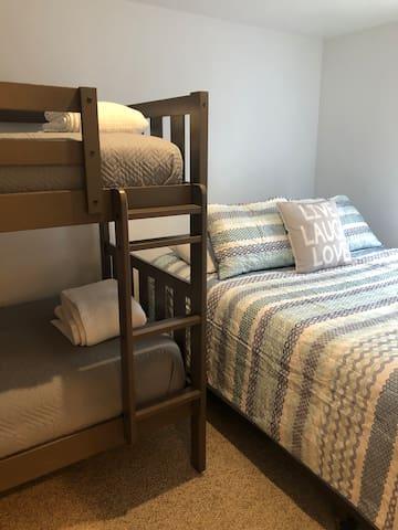 Second bedroom. Queen bed and twin bunk beds.