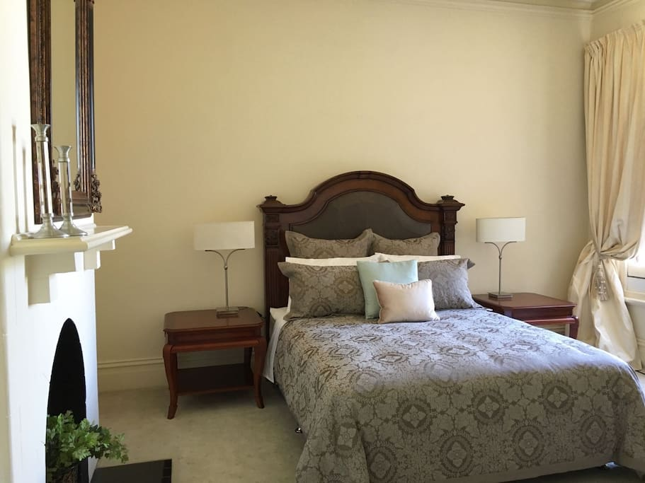 Well lit and spacious bedroom with king bed