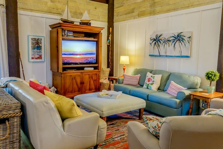Family and Friends  gathering space with 25' high ceilings! Blue sofa pulls out to be a very comfortable temperpedic foam queen sleeper sofa. All linens are provided! There's a desk and chair in the room for those that have to work while on vacation!