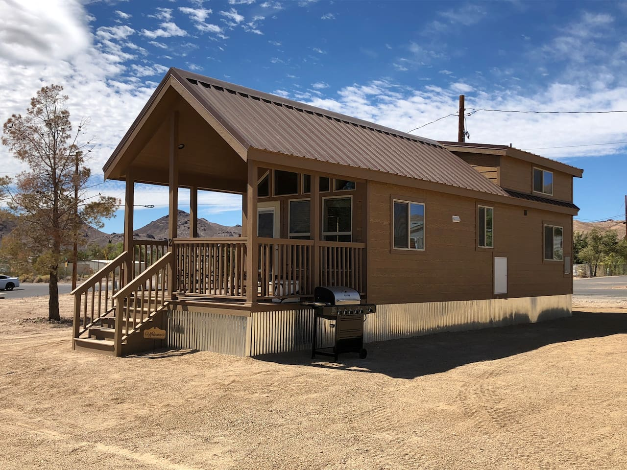 Wild West 2 - Death Valley Getaway Cabin will impress you with rustic charm and great hospitality.  Amenities include your own personal grill and covered porch.  Sit by the fire pit in the evening and Star Gaze with friends.