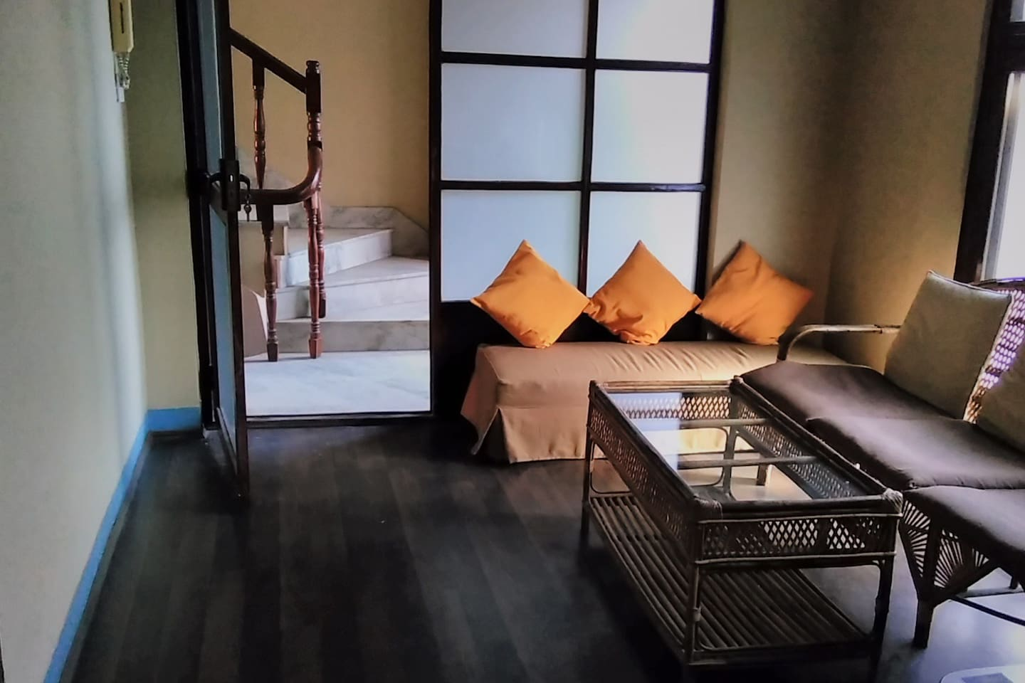 Living room with main entrance view