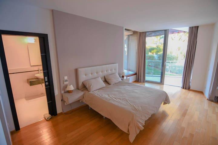 Master bedroom with bathroom, own wardrobe & terrace