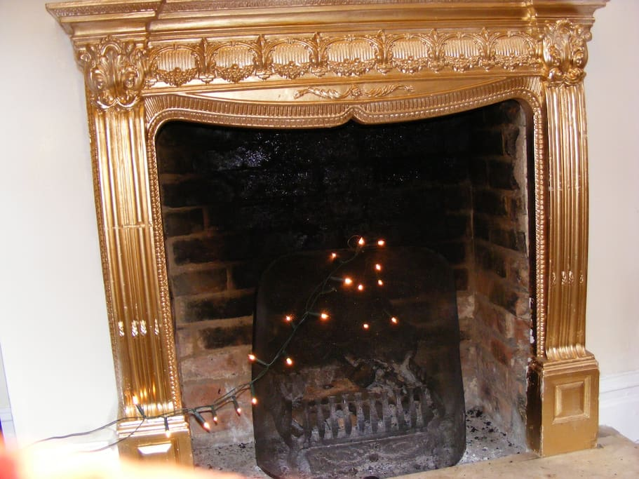 a large fireplace for candles or real log fires