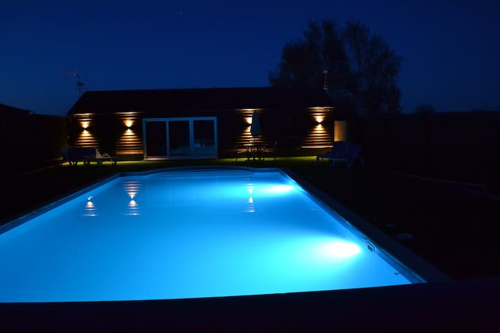 All lit up. The pool looks very inviting for an evening dip.