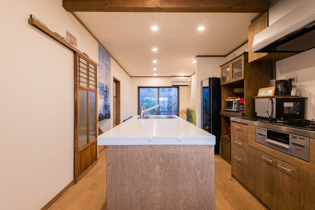 The island kitchen located in the middle of living space