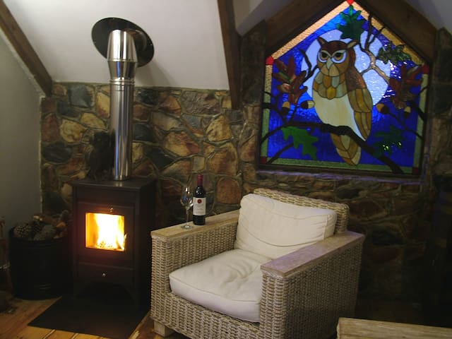 Relax with a glass of wine in front of the fire