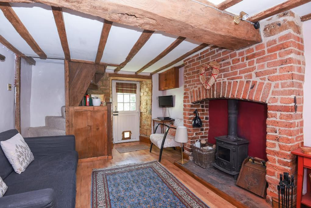 large traditional wood burner and feature fireplace