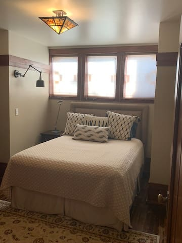 The bedroom features a Queen size bed and...