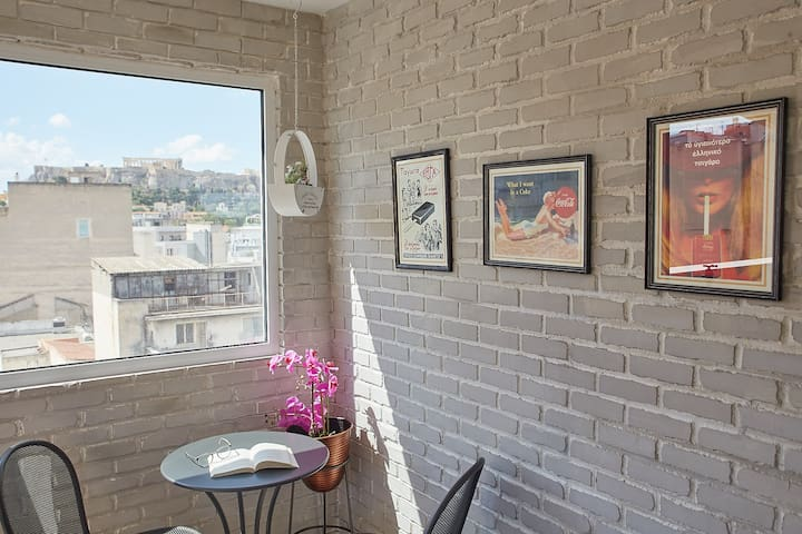 The shared rooftop terrace on the 6th floor, offering a magnificent Acropolis view!