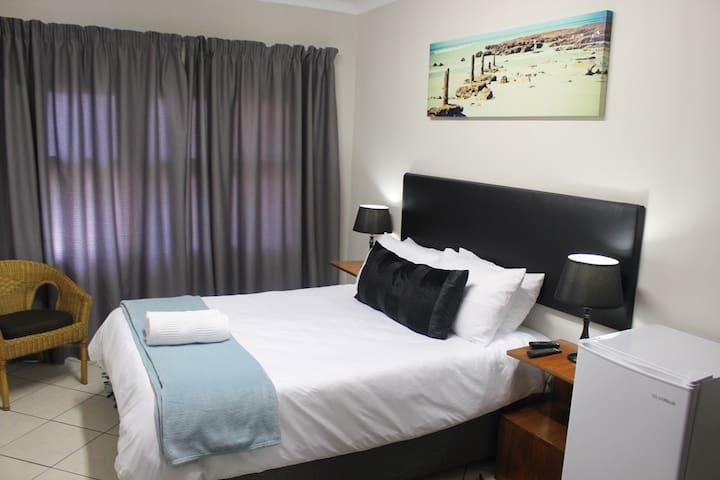 Room 3, double bed with en-suite bathroom, TV and fridge