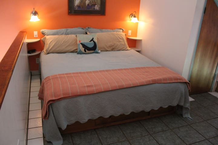 Upstairs sleeping loft offers King size comfy bed with new gel topper and fresh linens. Fall asleep to the sounds of paradise!