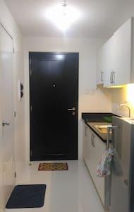Affordable Studio Unit beside LRT2 Gilmore Station - Condominium