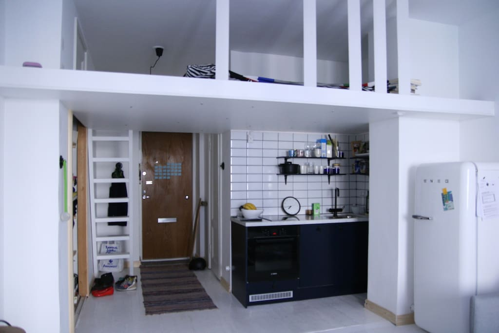 Stairs lead to the loft bed