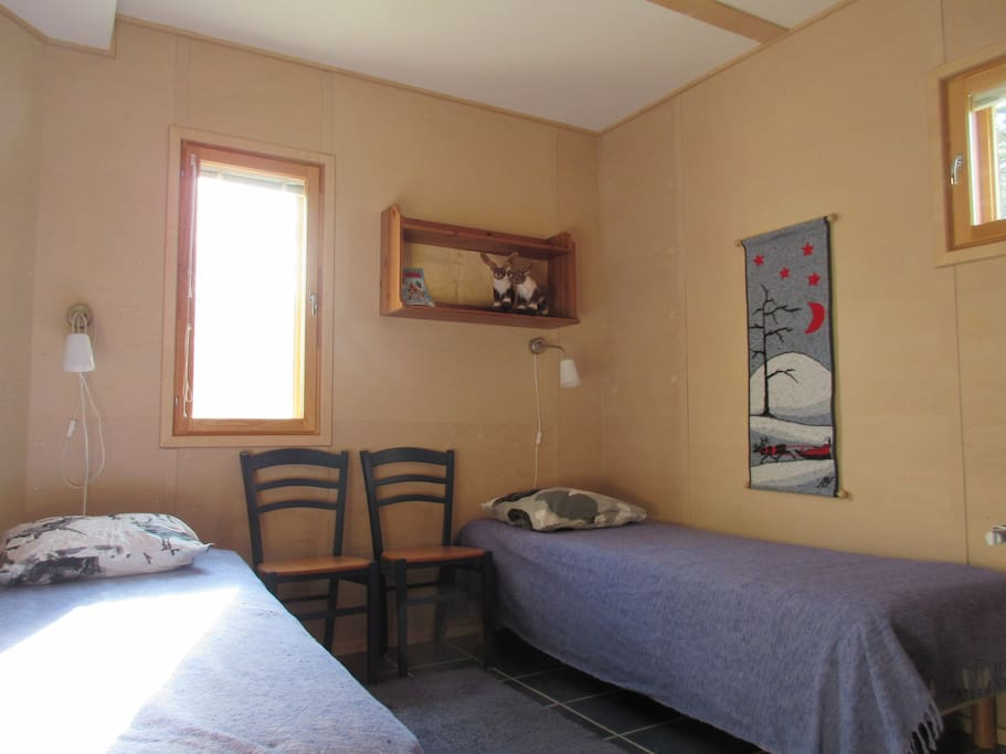 private room with two single beds