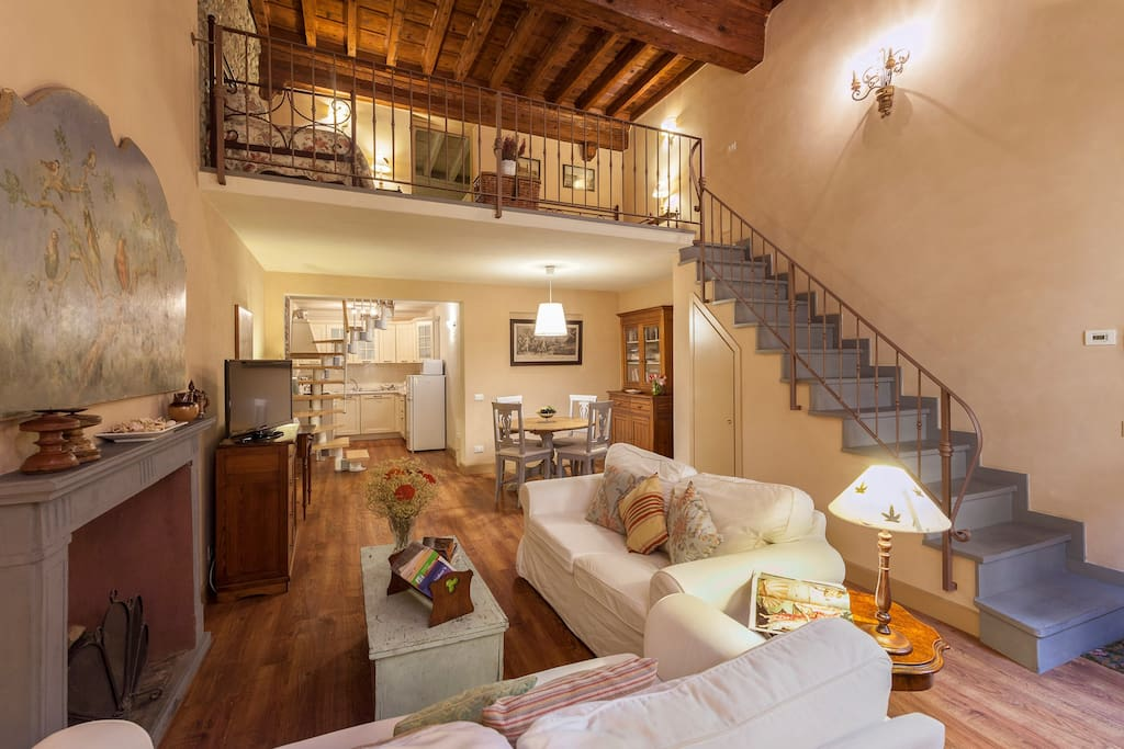 This is the living room with the high wooden ceiling and the large stair in stone