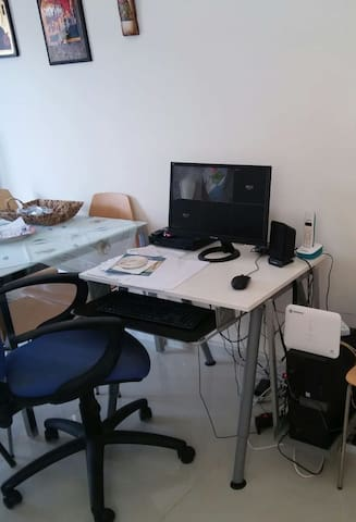 Working desk with computer and wi-fi internet connection