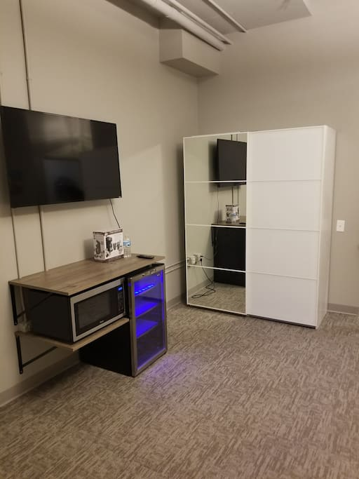 50 inch smart TV, microwave and mini fridge for guest use. Extra large storage closet with full size mirrored door.