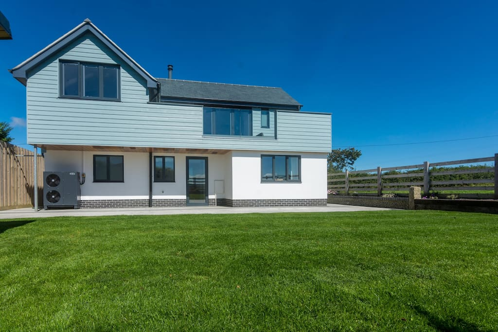 South facing garden backing onto fields and the Cornish countryside.