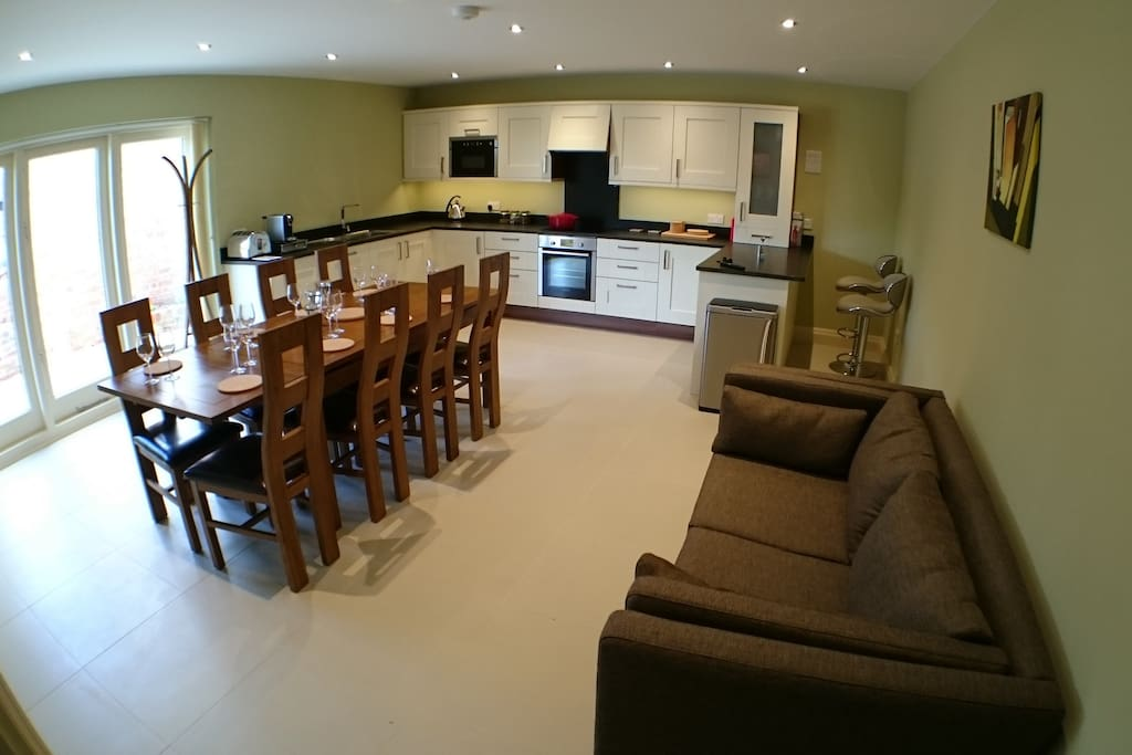 Spacious, fully-equipped kitchen - table seats 8-10, sofa, barstools, flatscreen TV