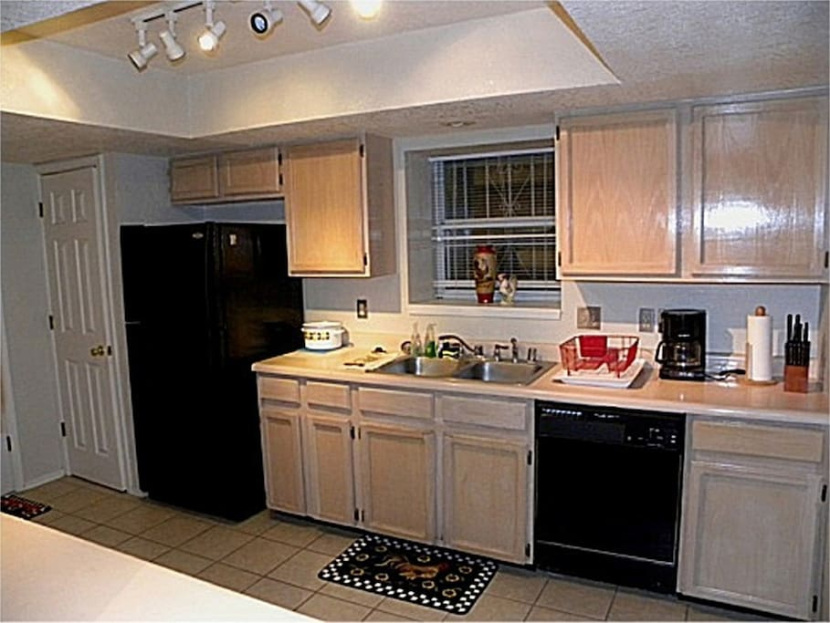 Fully furnished kitchen with all major appliances, microwave, cookware, utensils and dinnerware.