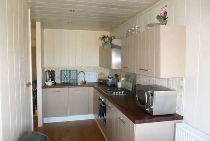 Kitchen fully equipped with oven, cooker, fridge etc.