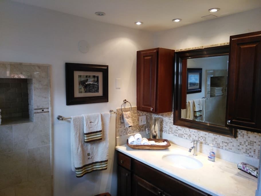 Plenty of cabinetry for toiletries and essentials. Foot stool. Space heater, exhaust fan and superior lightning enhance your mood and creates a cozy atmosphere