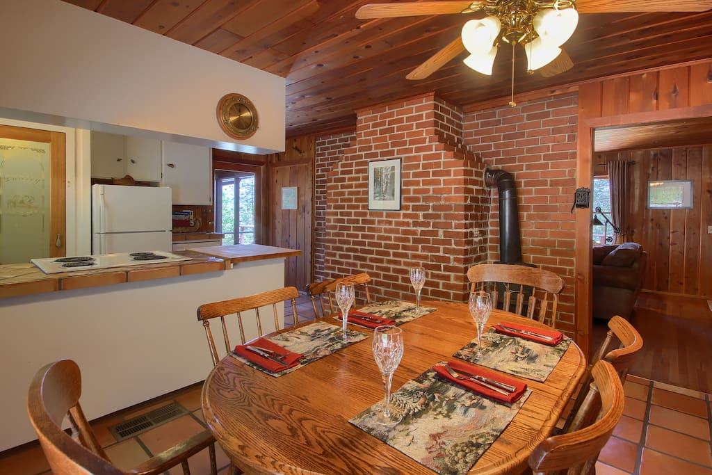 Enjoy radiant warmth from brick wall shared by living & dining room.