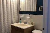 Shared bathroom with tub and shower