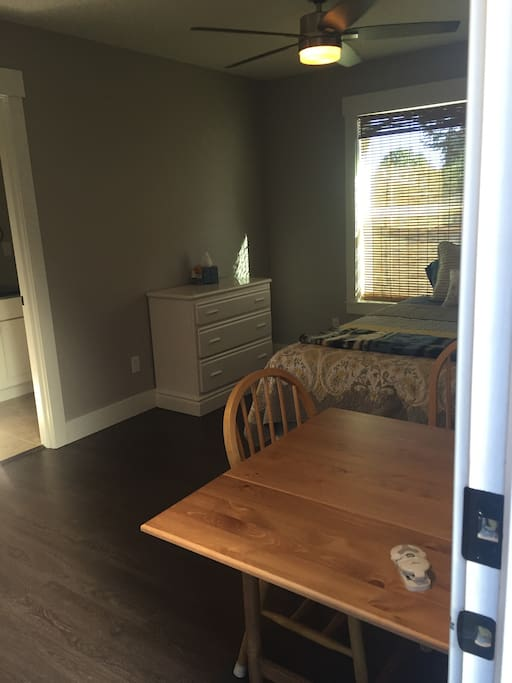 Spacious studio with convertible dining table/desk.