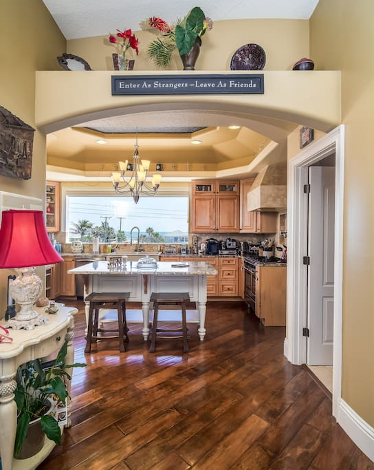 Chef's kitchen with kitchen island overlooking Atlantic ocean