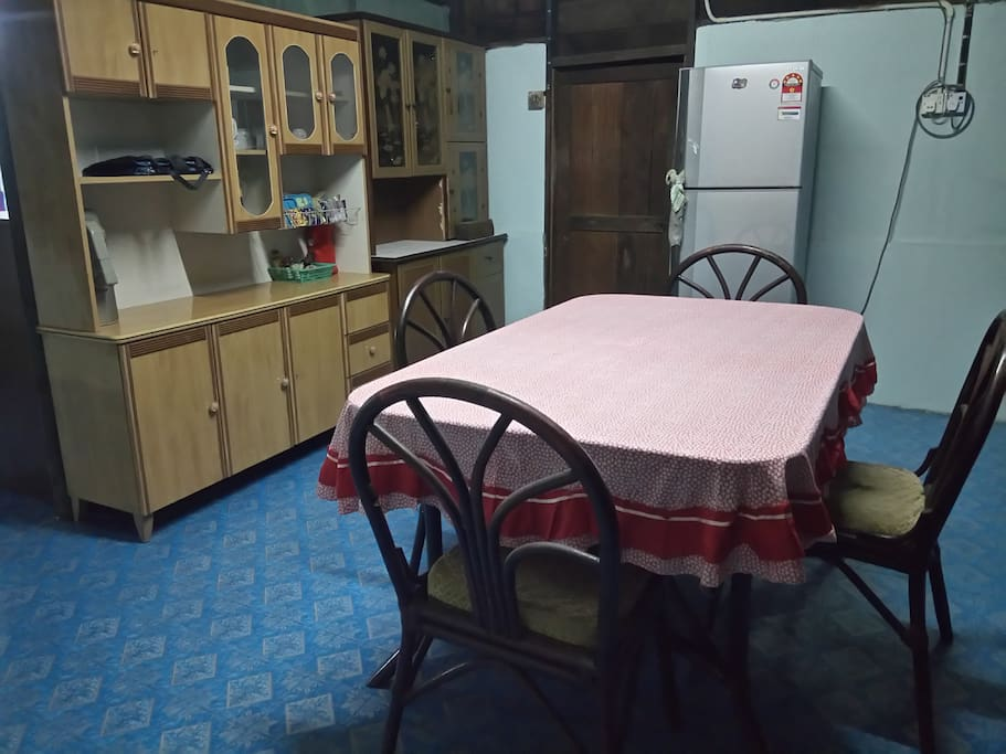 Comfortable dining area equipped with a refrigerator.