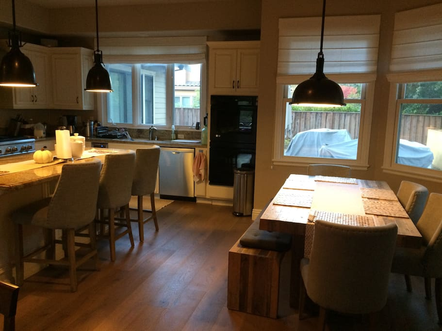 Cook a  beautiful meal and enjoy friends and family in this gourmet kitchen. Double ovens and a six-burner range make cooking fun! Enjoy a glass of wine and good conversation, while your family gathers around the granite island. Table seats 6.