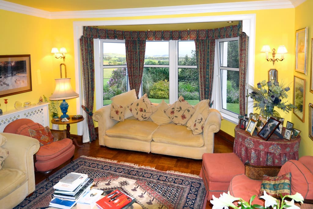 The drawing room with a view of the garden