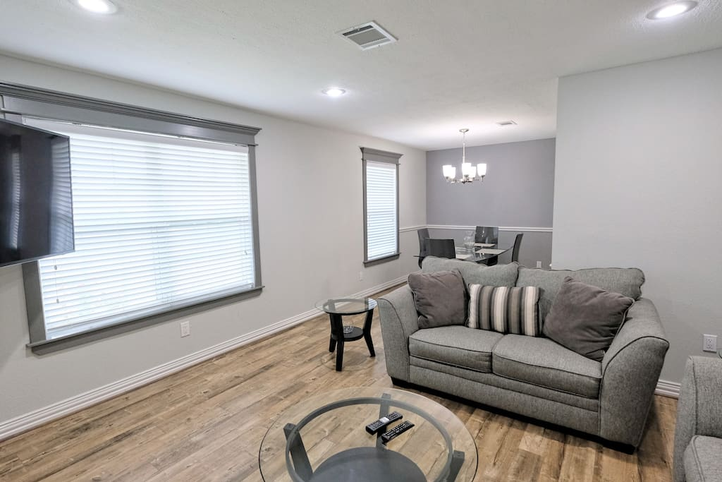 """Second living space with 55"""" wall mounted TV and cable."""