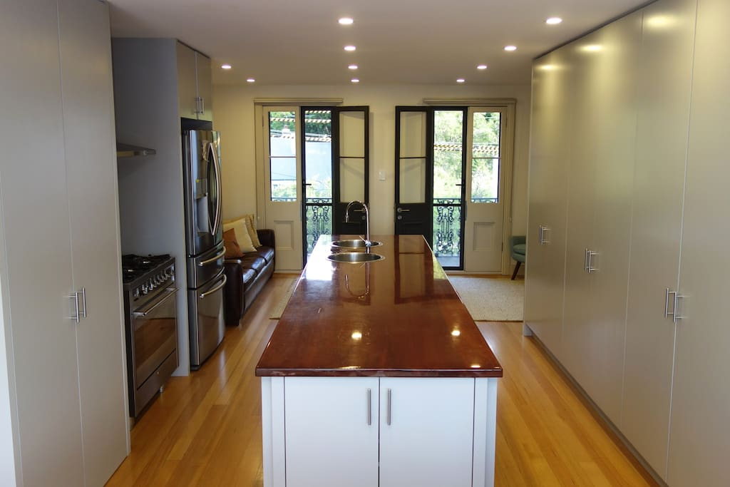 Kitchen area with open plan entertaining space.