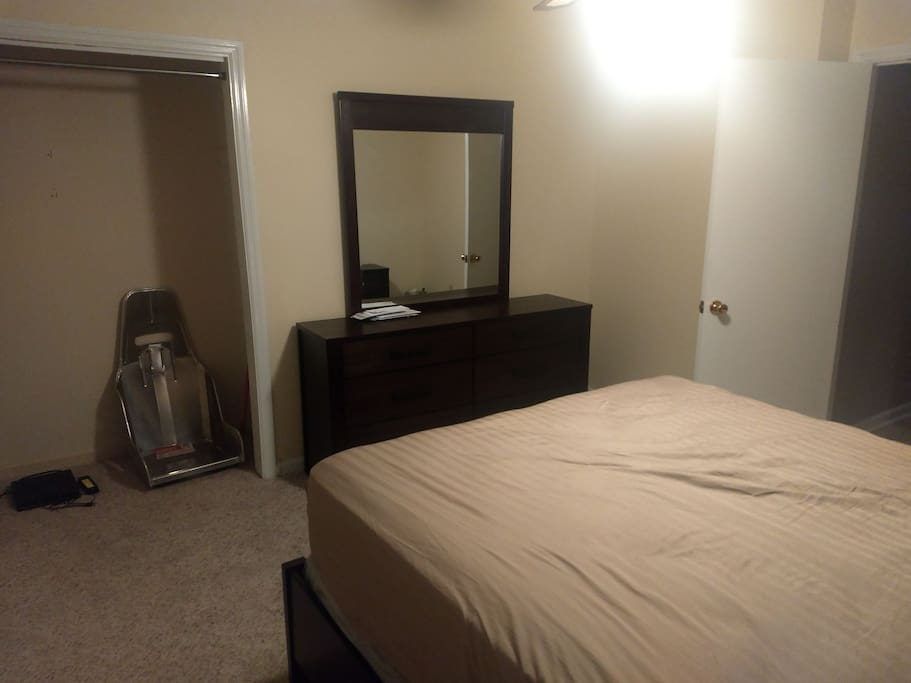 Bedroom#2 with a queen bed, television and cable right next to the 2nd full bathroom