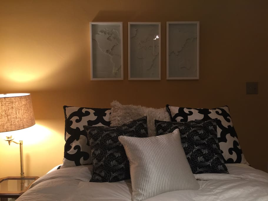 Comfy Queen bed with crisp white sheets, pull down the black out shades and sleep in.