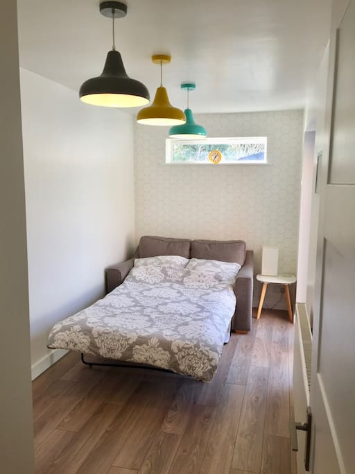 Bedroom with small double sofa bed