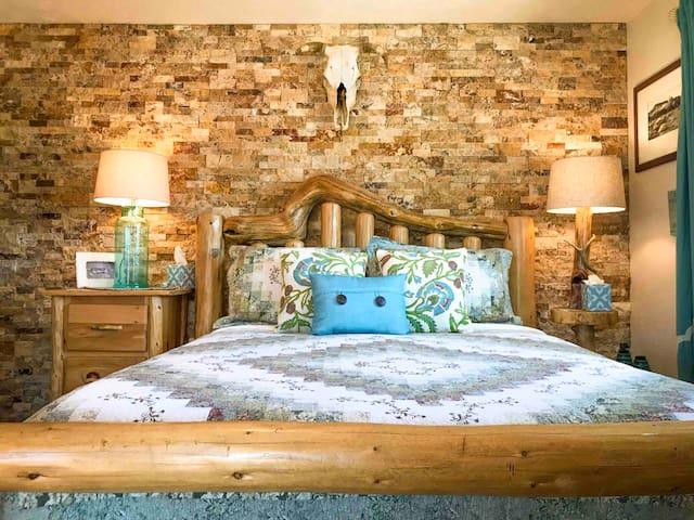 Bedroom one. Queen bed.