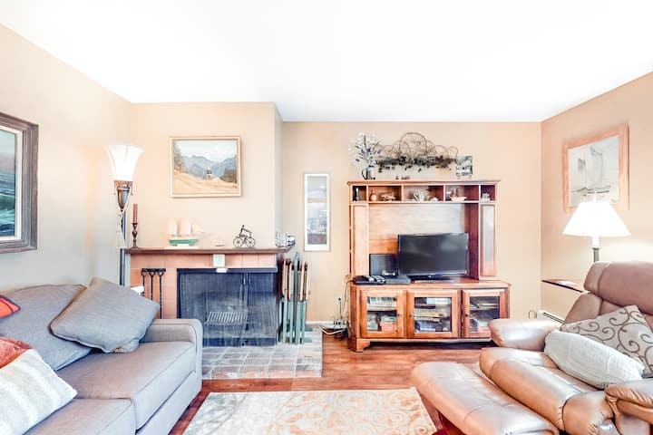 Downtown condo with lake and mountain views, wood fireplace & shared sauna!