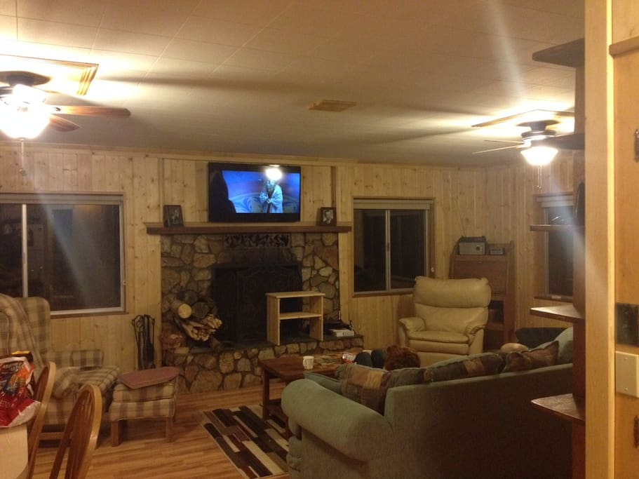 Comfortable living room with fireplace and flat screen TV