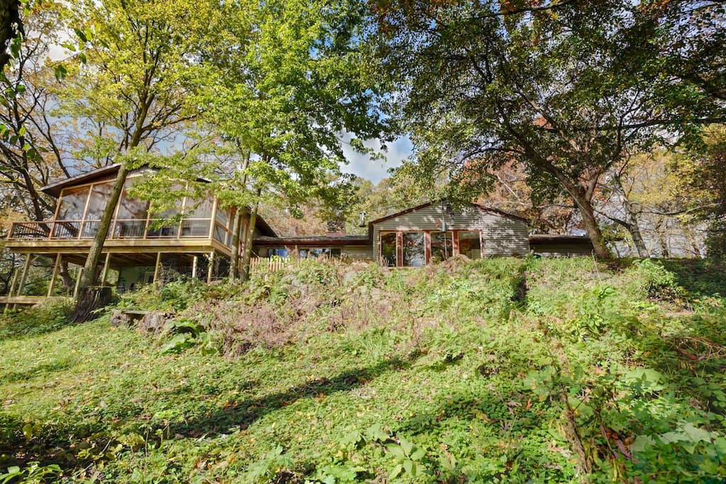 The house is situated on a bank above Koshkonong Creek.  Large windows, decks and a screened porch invite you to enjoy woods and water views in every season.
