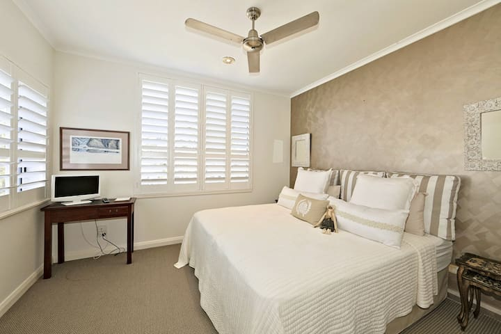 Second bedroom with 2 king single ensembles.  Views to the ocean, ceiling fan and ducted a/c.  Walk in robe.  Very large bedroom.
