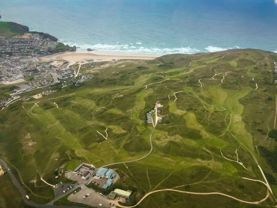 Aerial photos of golf course with accommodation secluded in the middle