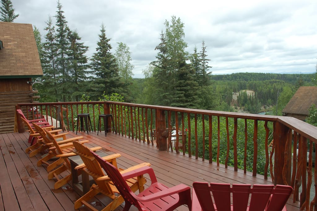 Harmony Lodge deck seating for 8 with view of Kenai River and Kenai Mountains
