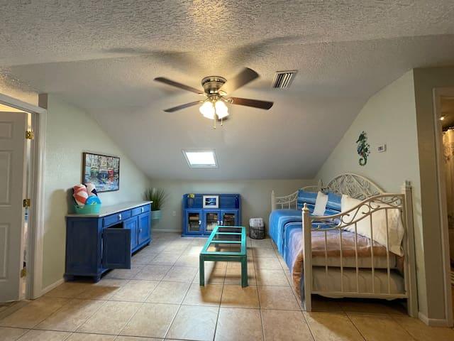 Daybed contains two, clean twin size mattresses.  Large, fluffy beach towels are provided for each guest.  Extra soft blankets are available for added comfort. Games and books are located in the cabinet.