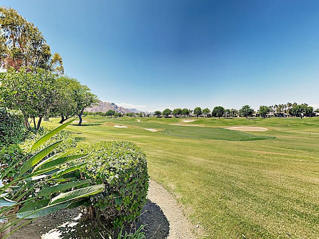 Nestled on the 15th fairway of the PGA West Stadium Golf Course, this condo boasts a stunning backyard view.