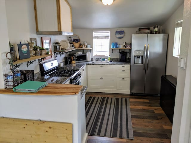 Very open space between living room and kitchen.  Great for continuing conversations or sitting together for a meal.