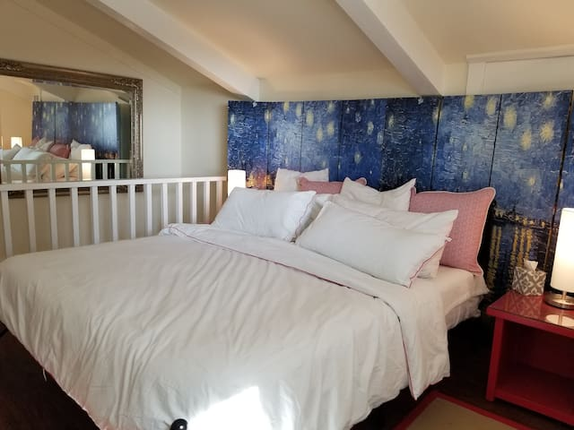 Your bedroom is located upstairs and features a California King bed,  all cotton linens and a  large writing desk
